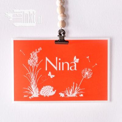 Letterpress geboortekaartje met wilde bloemen en egeltje
